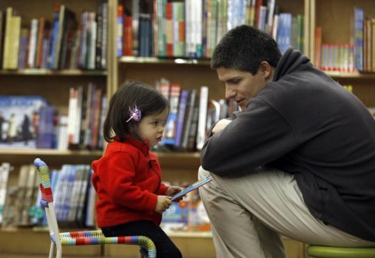 Amanda Springmuller, 18 months, talked about a book with her father, Daniel, at Brookline Booksmith.