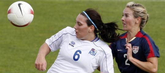 Heather Mitts (right, battling Iceland's Holmfridur Magnusdottir) is an outstanding defender.