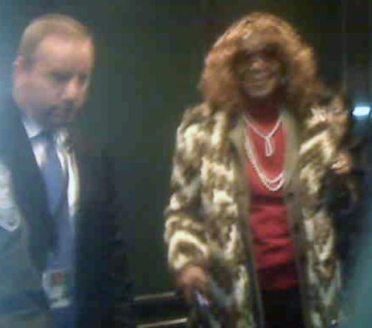 Zeituni Polly Onyango, 56, wearing a rust-colored wig, was captured in this cellphone photo leaving an immigration hearing yesterday in Boston. She is fighting deportation to her native Kenya.