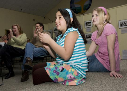 Katelyn d'Entremont, 11, (right) of Franklin and Sarah Randall, 9, of Wrentham at the Circle of Friends Coffeehouse.