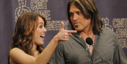Billy Ray Cyrus says daughter Miley ''was just a natural-born entertainer'' the first time she walked onstage and held a microphone.