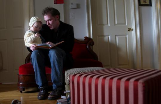 Writer Craig Leaf at home in Lowell with son Versailles, age 2.