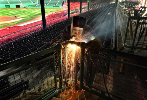 Final preparations were being made at Fenway Park on Thursday for Monday's Red Sox Opening Day. Iron worker Erik Anderson welded a steel bar into the railing of the stands with an arc welder.