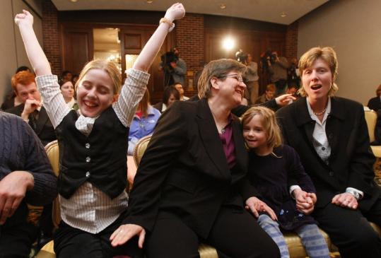 CHRISTOPHER GANNON/DES MOINES REGISTER VIA ASSOCIATED PRESS Dawn BarbouRoske (center) of Iowa City and her partner, Jen BarbouRoske, with daughters McKinley, 11, and Bre, 6, rejoiced yesterday after learning of the Iowa Supreme Court ruling in favor of legalizing gay marriage in Des Moines.
