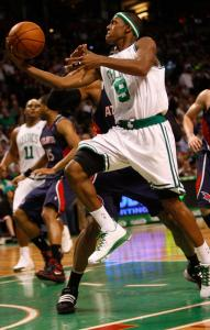 Celtics point guard Rajon Rondo is comfortably ahead of the pack as he drives for a layup during the first half.