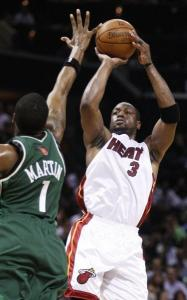 Dwyane Wade had 27 points and 10 assists in Miami's postseason-clinching victory.