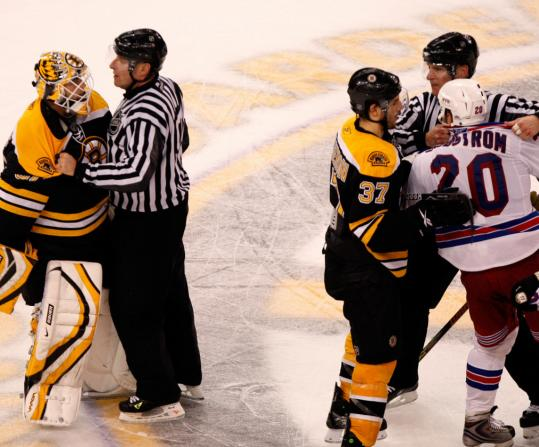 Tim Thomas (far left) was separated from Sean Avery (far right), who had to answer to Steve Montador after whacking the Bruins goalie in the head with his stick.