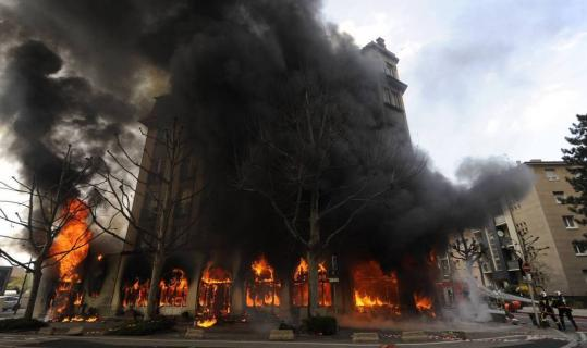 Firefighters battled a blaze yesterday at a hotel in Strasbourg, France, set by demonstrators protesting the NATO summit. Protesters also set a border post on fire, and riot police used tear gas.