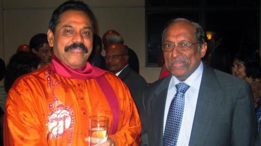 Sritharan Thillaiampalam, pictured with the Sri Lankan president, now thinks it might be wise to work with the government.