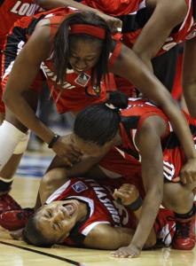 Angel McCoughtry screams with joy after Louisville beat Oklahoma to advance to its first NCAA championship game.