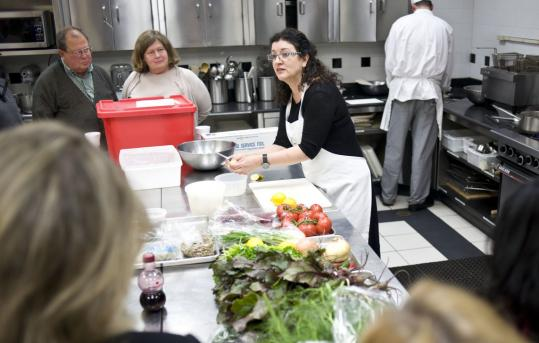 Janna Gur (right) does a cooking demonstration at the Cambridge School of Culinary Arts.