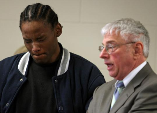 David Johnson (left), seen with lawyer Elliot Levine, pleaded not guilty to five counts related to his alleged role in the October 2007 killing of Steven Odom, an eighth-grader who played the drums at his father's church and wrote about ending street violence.