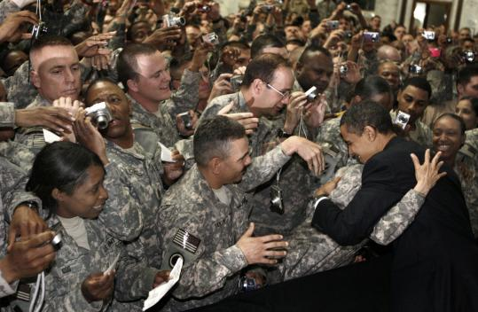 President Obama greeted troops yesterday at Camp Victory in Baghdad.