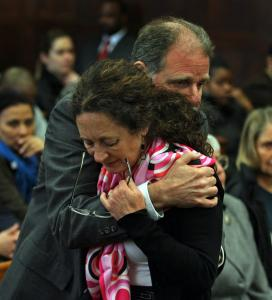 William and Grazia Levin, parents of the slain woman, embraced after Grazia's impact statement in court yesterday that said in part: ''I am walking this world as a ghost.''