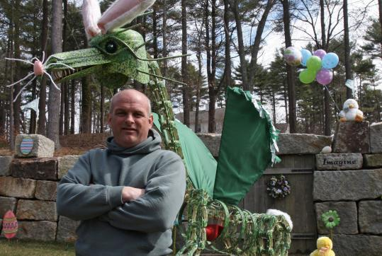 Chuck Nudd of Duxbury built Draco the dragon, who's been embraced by the town, with creative use of a compressor tank and a pick ax.