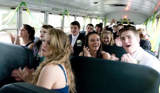 Earlier this month, promgoers from King Philip Regional High in Wrentham hitched a ride aboard a yellow school bus driven by a student's parent.