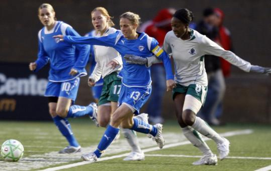Kristine Lilly (13) beats Saint Louis's Tina Ellertson in the race for the ball in the Breakers' home-opening win at Harvard Stadium. Lilly scored the team's second goal.