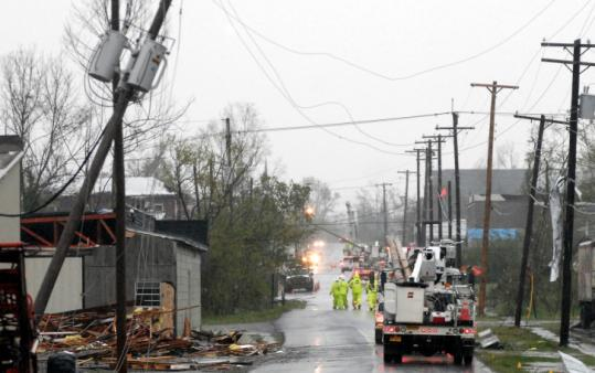 Utility crews worked to restore power yesterday in Mena, Ark., where a tornado struck on Thursday, killing three people.