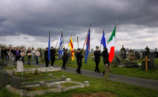 A Sinn Fein color party paraded through a Northern Ireland cemetery yesterday to commemorate the 1916 Easter Rising.