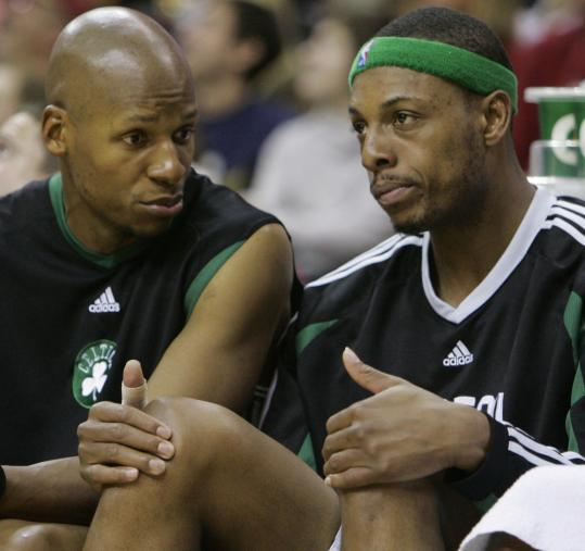 Celtics veterans Ray Allen (left) and Paul Pierce take it all in as their team is getting clobbered by the Cavaliers.