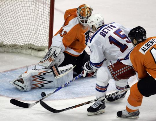 The Rangers' Blair Betts beat Flyers goalie Martin Biron for this third-period goal that stood as the winner.