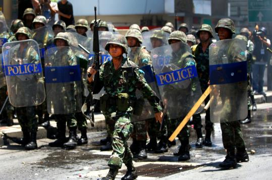 Security forces in Bangkok clashed with protesters as the government declared a state of emergency yesterday.