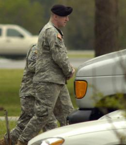 Army Sergeant Joseph Bozicevich was led from court during a break yesterday.