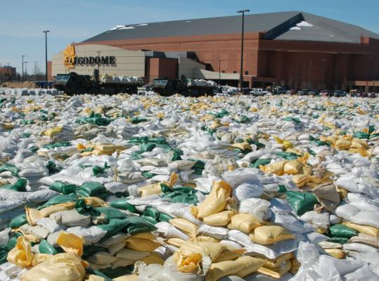 Sandbags covered the parking lot of the Fargodome, an indoor football stadium and concert arena, in Fargo, N.D., last week.