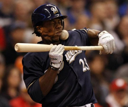 Some fourth-inning chin music got too close for the Brewers' Rickie Weeks, who couldn't avoid getting hit by the Reds' Edinson Volquez.