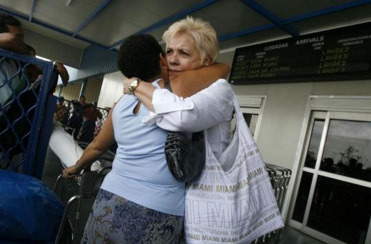 Above, Cubans welcomed relatives arriving yesterday from the United States at Havana's Jose Marti Airport.