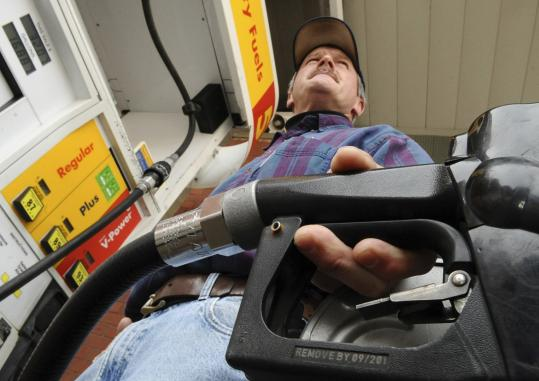 A government forecast suggests that gasoline prices will stay relatively low this summer because of continuing struggles in the economy. The average monthly price should top out at about $2.30 a gallon, well below the $4 spikes in 2008.