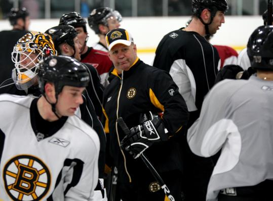 Claude Julien is the center of attention as he inspects his troops before the Bruins open the playoffs vs. Montreal tomorrow.