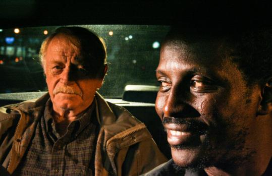 Red West (left) as William and Souléymane Sy Savané as Solo, men headed in different directions in ''Goodbye Solo.''