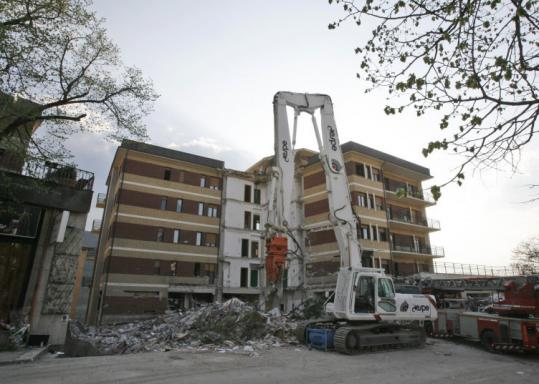 Alessandra Tarantino/associated pressA dormitory at the university in L'Aquila, Italy, partially collapsed in the April 6 quake. Some students returned to classes yesterday, some in the tent camps now their homes.