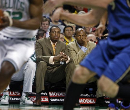 Paul Pierce (left) and Ray Allen were spectators last night as the Celtics finished off the regular season - and the Wizards.