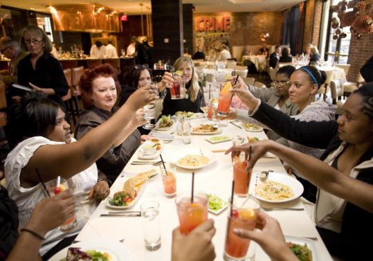 Chef Lydia Shire (second from left) and students from Lewis Middle School in Roxbury gave a toast during a fancy dinner at Scampo in The Liberty Hotel.