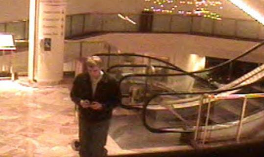 An image released by police of a man wanted in connection with the shooting of a woman at the Marriott Copley Hotel.