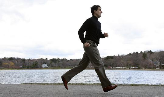 Mark Lowenstein runs along the Brookline Reservoir, among the routes in his book.