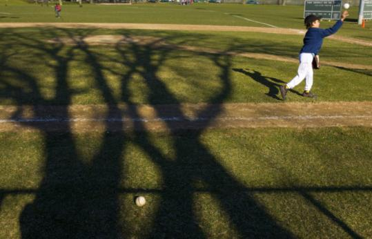 Gordon Jacobs, 7, of Boston readied for a Little League practice at the Teddy Ebersol Field on the Esplanade this week.