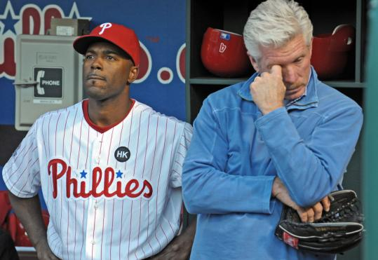 Jimmy Rollins and former Phillies great Mike Schmidt get emotional during a tribute to broadcaster Harry Kalas, who died of a heart attack this week.