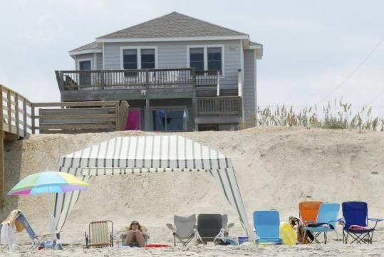 Karen and Dan Kegelman used to rent a house with family on the Outer Banks every year, but to economize this year, they're renting a condo in Delaware.