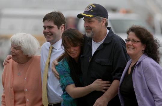 Captain Richard Phillips was greeted by his mother, Virginia (left), son, Daniel, daughter, Mariah, and wife, Andrea, yesterday in Burlington. ''I have always been proud to call myself an American,'' said Andrea. ''Today, I am even prouder.''