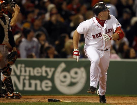 Kevin Youkilis, who had four RBIs, follows the flight of his three-run homer in the third.