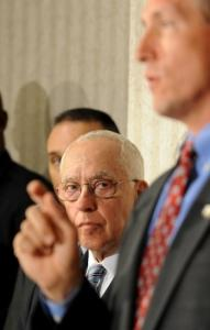 Former US attorney general Michael Mukasey (center) listened to a Georgia US attorney, David E. Nahmias.