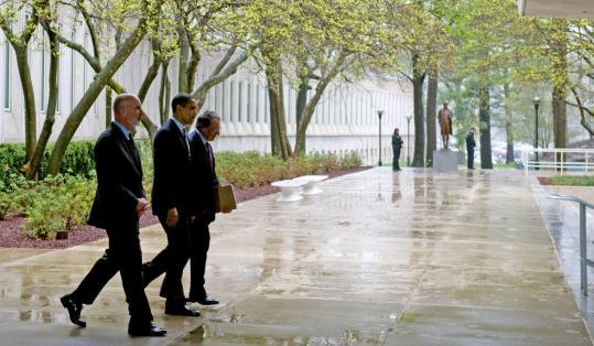 Stephen Kappes (left), a CIA deputy director, joined President Obama and the agency's director, Leon Panetta, for a stroll outside headquarters yesterday in Langley, Va.
