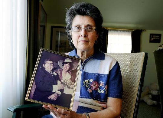 Claire Young held a photograph of her and husband, William, at the family home in Auburn, Maine, on Sunday.