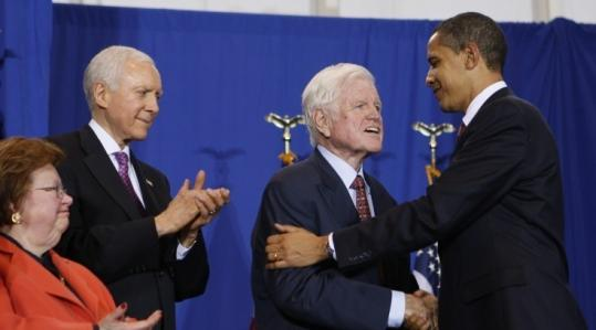 President Obama greets Senator Kennedy as Senators Orrin Hatch and Barbara Mikulski watch at yesterday's bill signing.