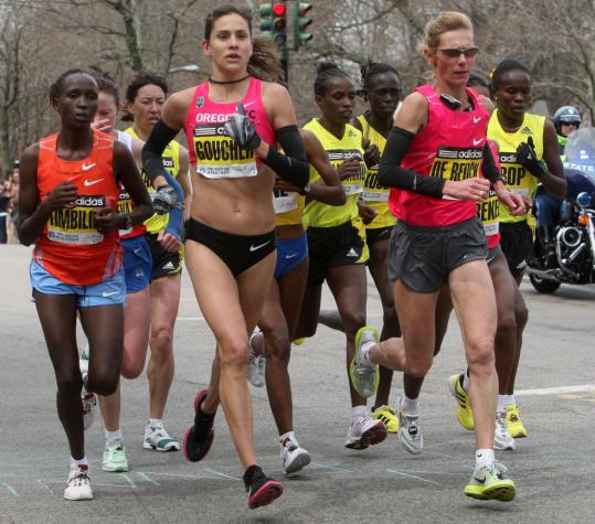 Kara Goucher, in the lead pack at Heartbreak Hill (above), finished third in the women's race.