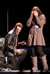 Tim Brennan of the Dropkick Murphys proposes to his girlfriend, Diana Ganz, during the Bruce Springsteen concert at the Garden on Wednesday.