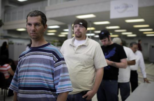 Joseph Sassi, 39 (left), waits in line to talk to a job counselor at a Nevada Jobconnect Career Center in Las Vegas yesterday.
